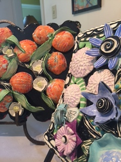 """I've always enjoyed making tiles, flat or with lots of relief, but lately it's become a focus of new work. The tiles range from 8""""w x 10""""t x 2"""" d to as large as 3'w x 3't x 3""""d.  It's the dense embellishments of flowers, leafs, fruit, bugs, and birds that I fill the tile surfaces, never enough to only paint on a flat tile."""