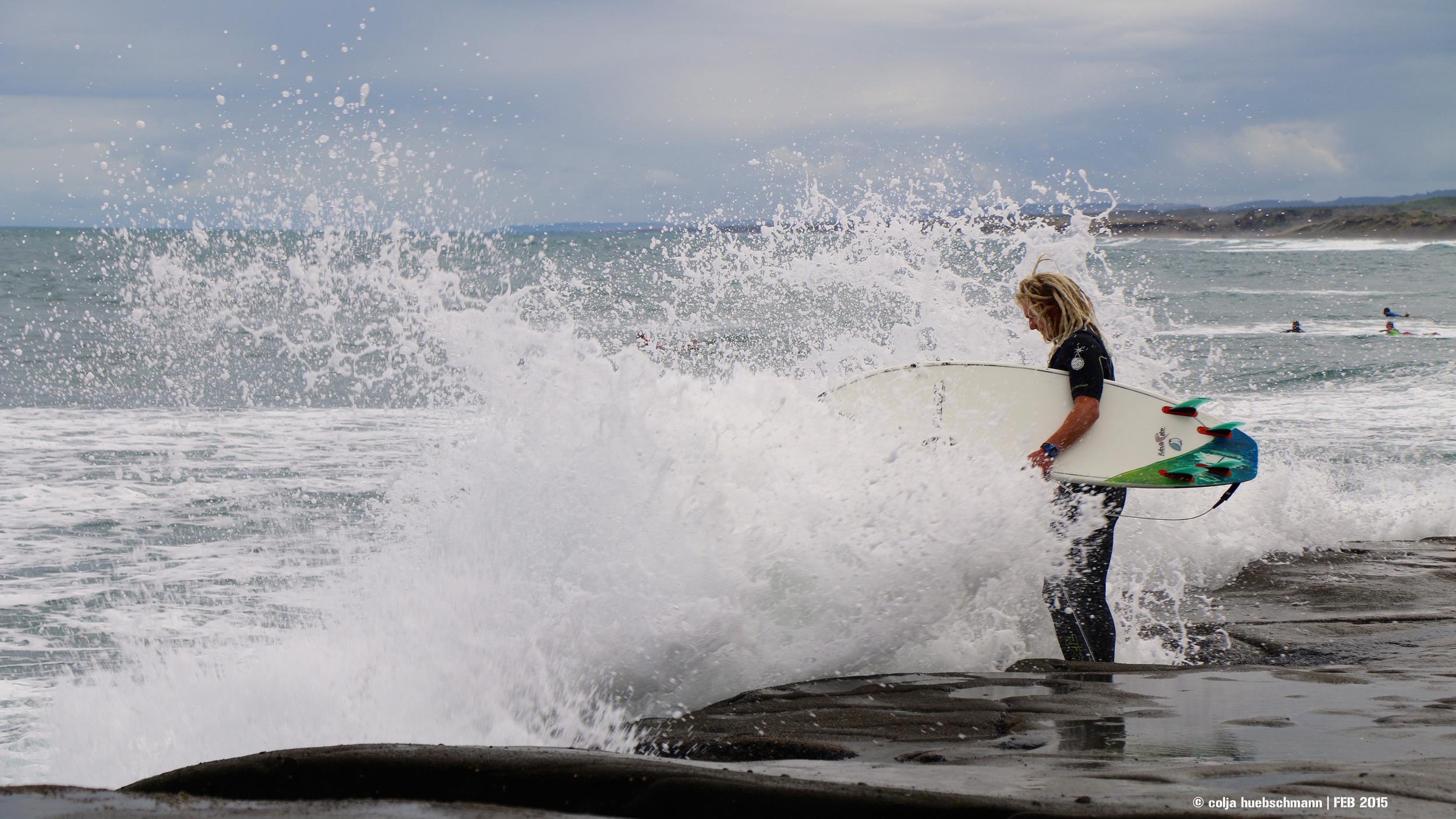 Surfer at Muriwai beach