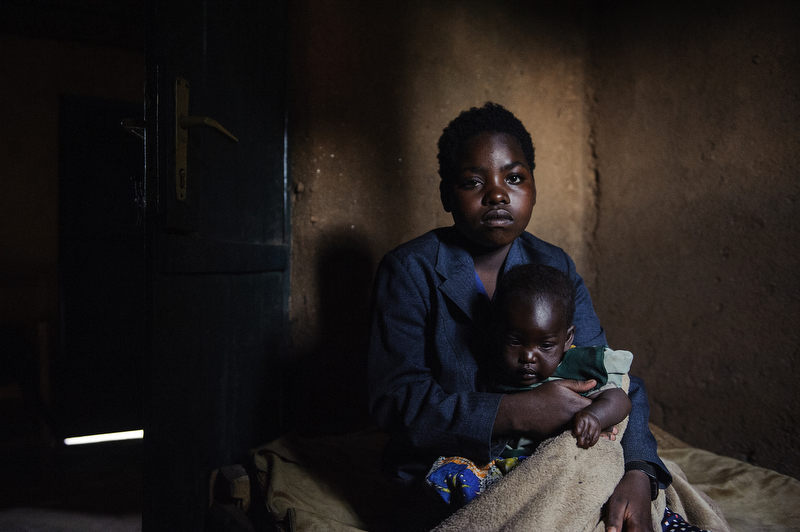 Médiatrice Nikolshaka, 16, with her 9-month-old daughter Filene, at home in Nyamiyanga Secteur, Musanze, Rwanda.