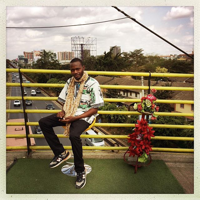 Augustine sells biscuits next to this photographer's setup on the Popo Rd flyover. 50 bob to get your portrait taken and printed as you wait. It's a deal. #nairobi #kenya #makeportraits