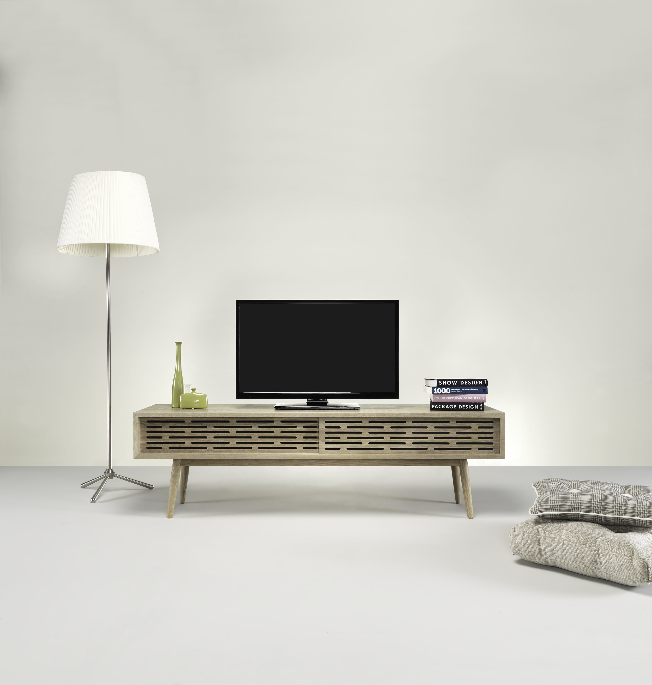 RADIO   Available in oak or walnut, it's a simple and smart solution for the TV unit. The perforated sliding doors are perfect for the electronic equipament, not only for the remotes, as well as airflow and cooling.