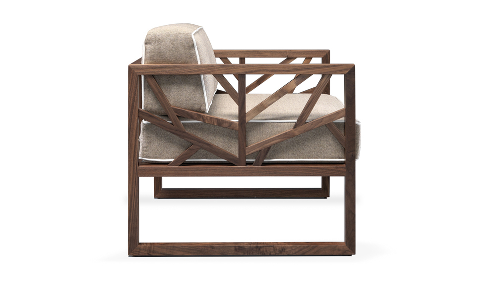 Tree  is a comfortable & modern armchair with a solid walnut frame which brings visual lightness to the design.
