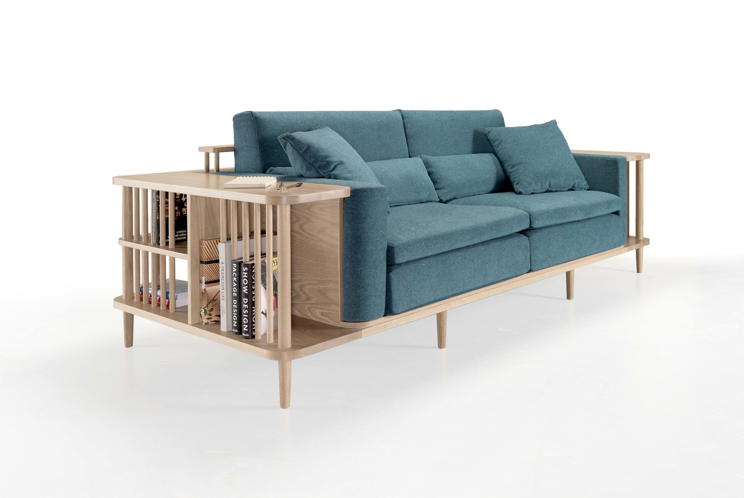 SCAFFOLD SOFA BY ANDRÉ TEOMAN   Its surrounding wooden frame allows you to use it as a bookshelf or as a division between the living room and dining room.