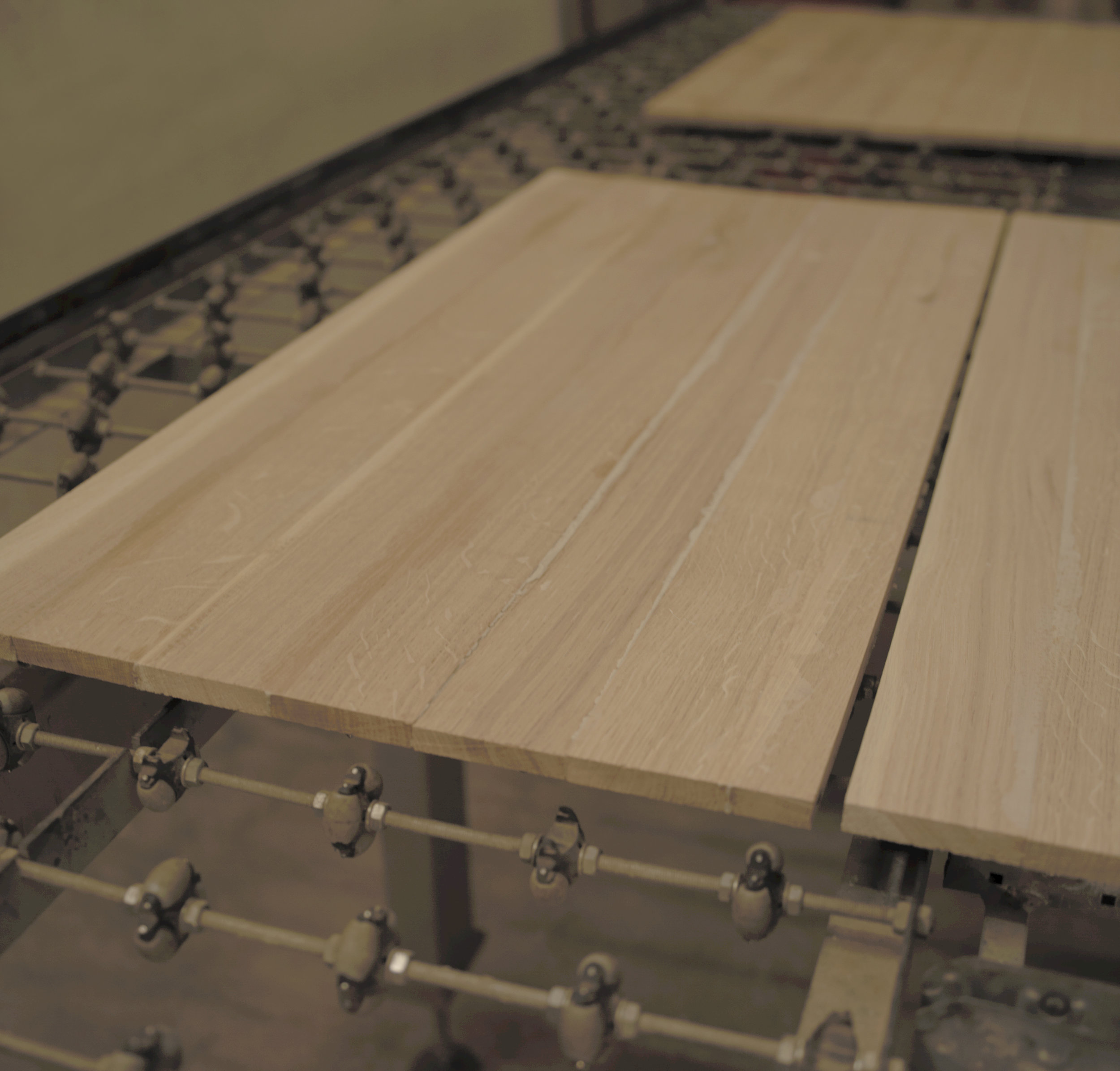 After cutting and gluing process, the wood pannel is converted into specific parts for the piece of furniture, using our CNC machines.