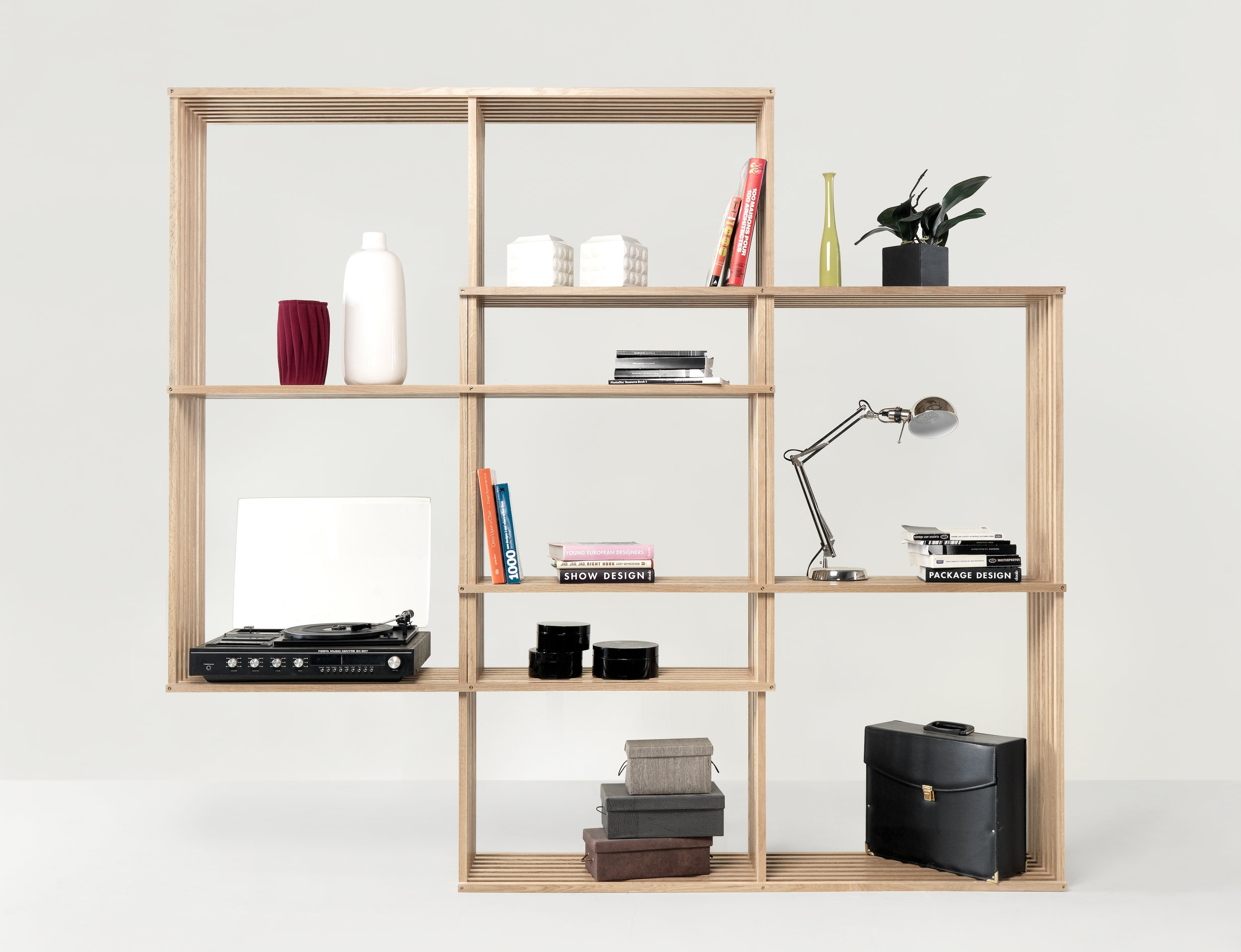 X2  from wewood is a smart bookshelf which allows increasing the width and height anytime, creating new storage compartments.