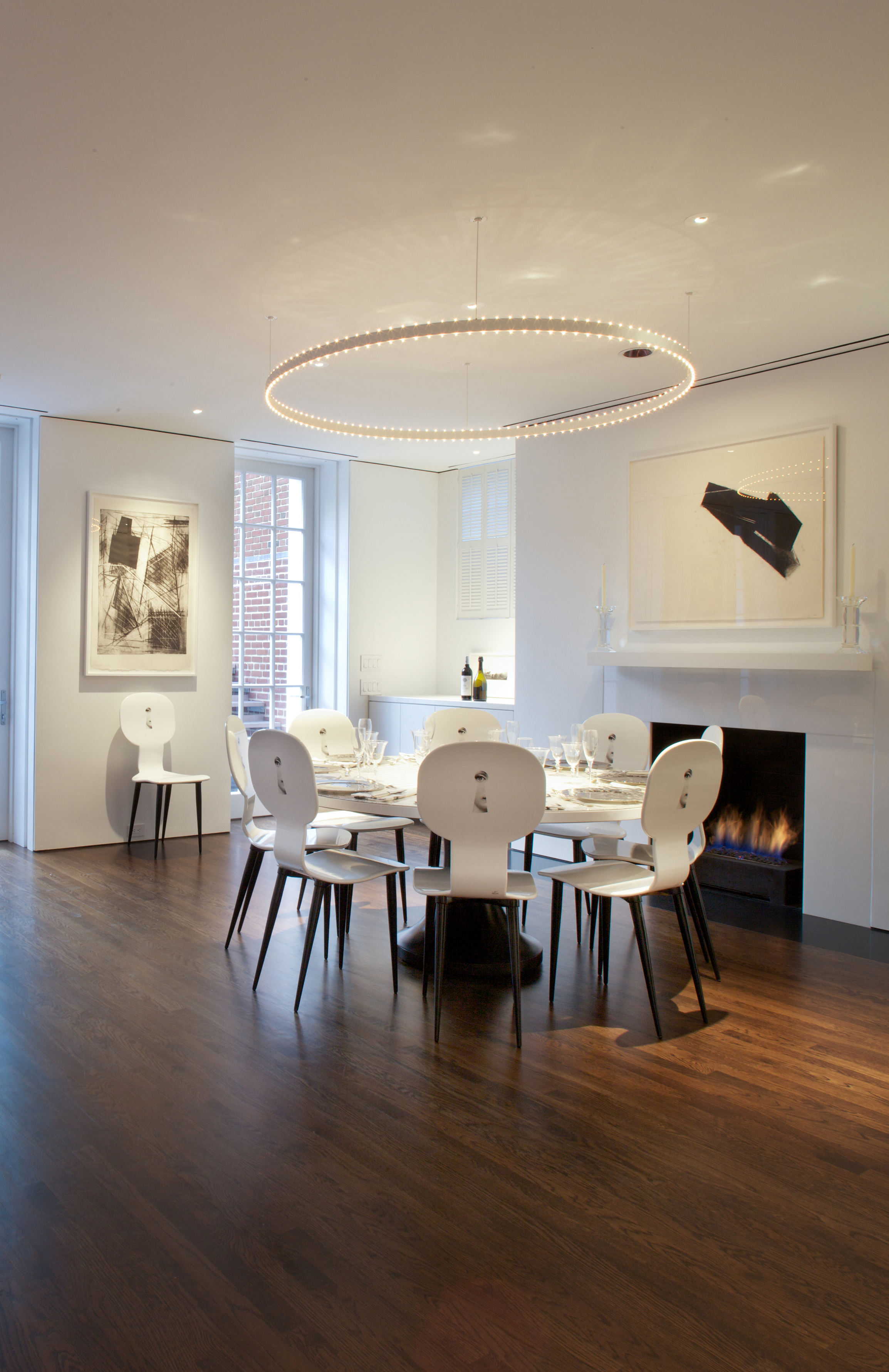 """Dining room with Jacobsen """"Halo"""" light."""