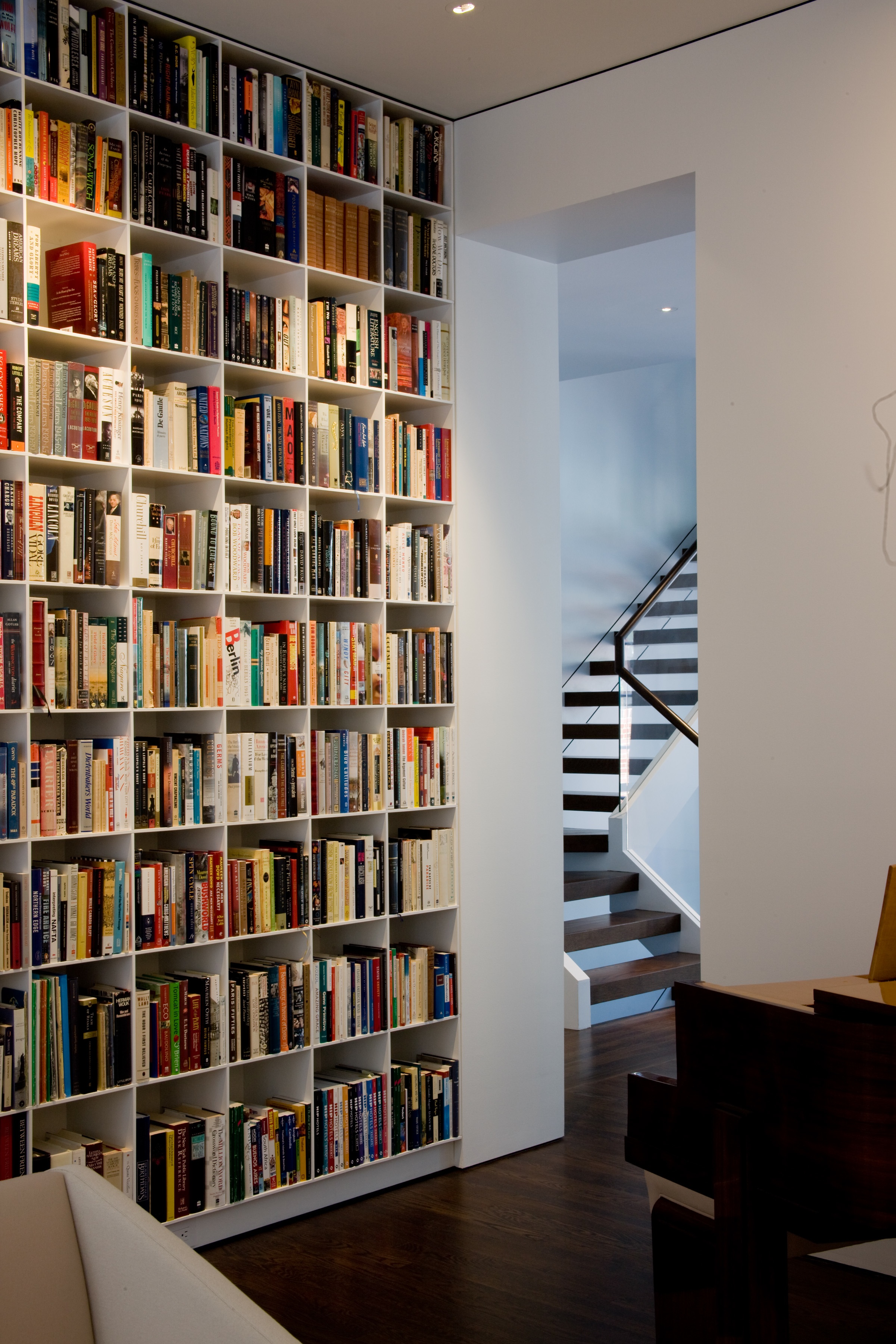 """Classic Jacobsen """"eggcrate"""" bookcases fill the room with colour."""