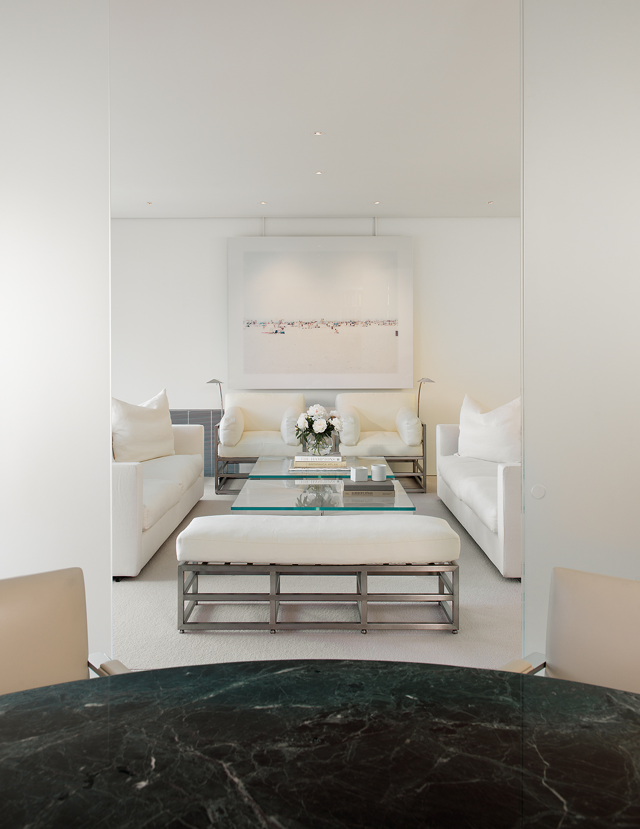 Sliding glass doors and Jacobsen designed furniture.