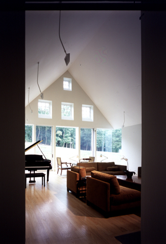 The gabled ceiling and cornerless windows.