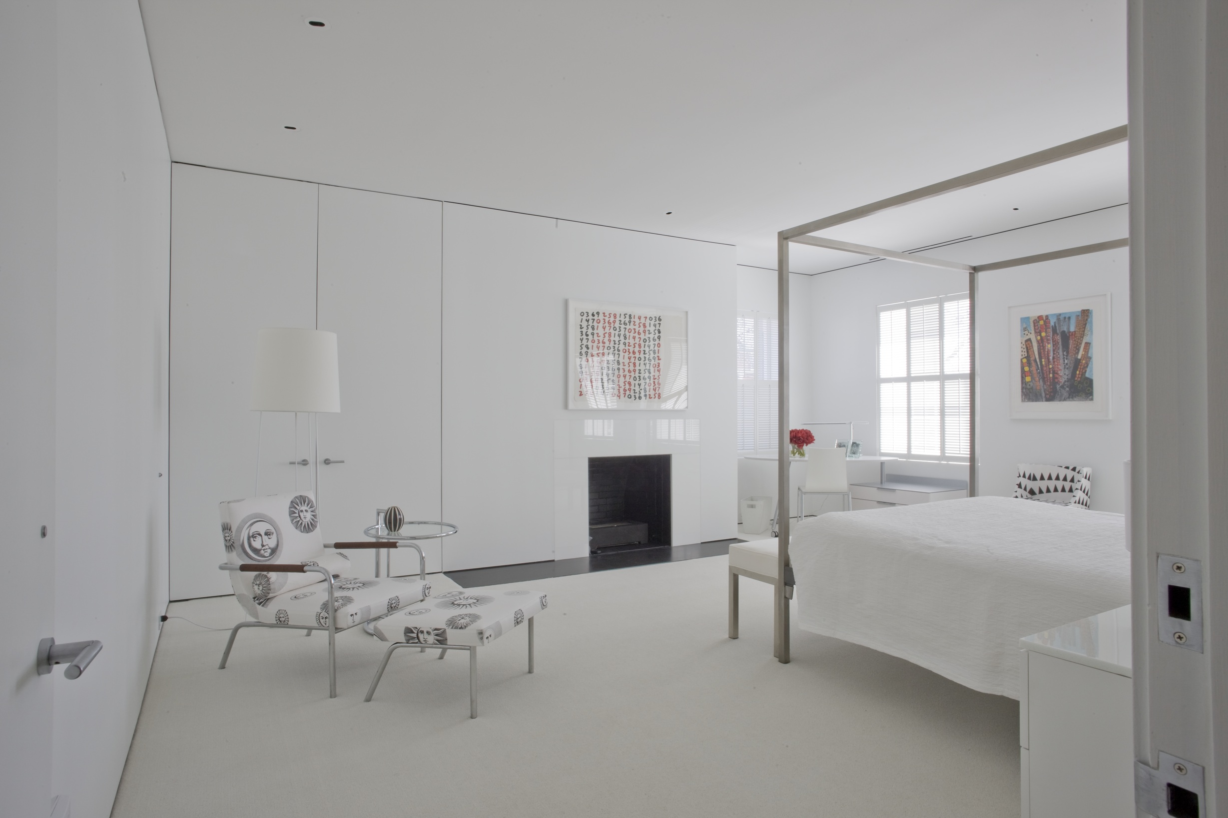 A minimal fireplace for a guest room.