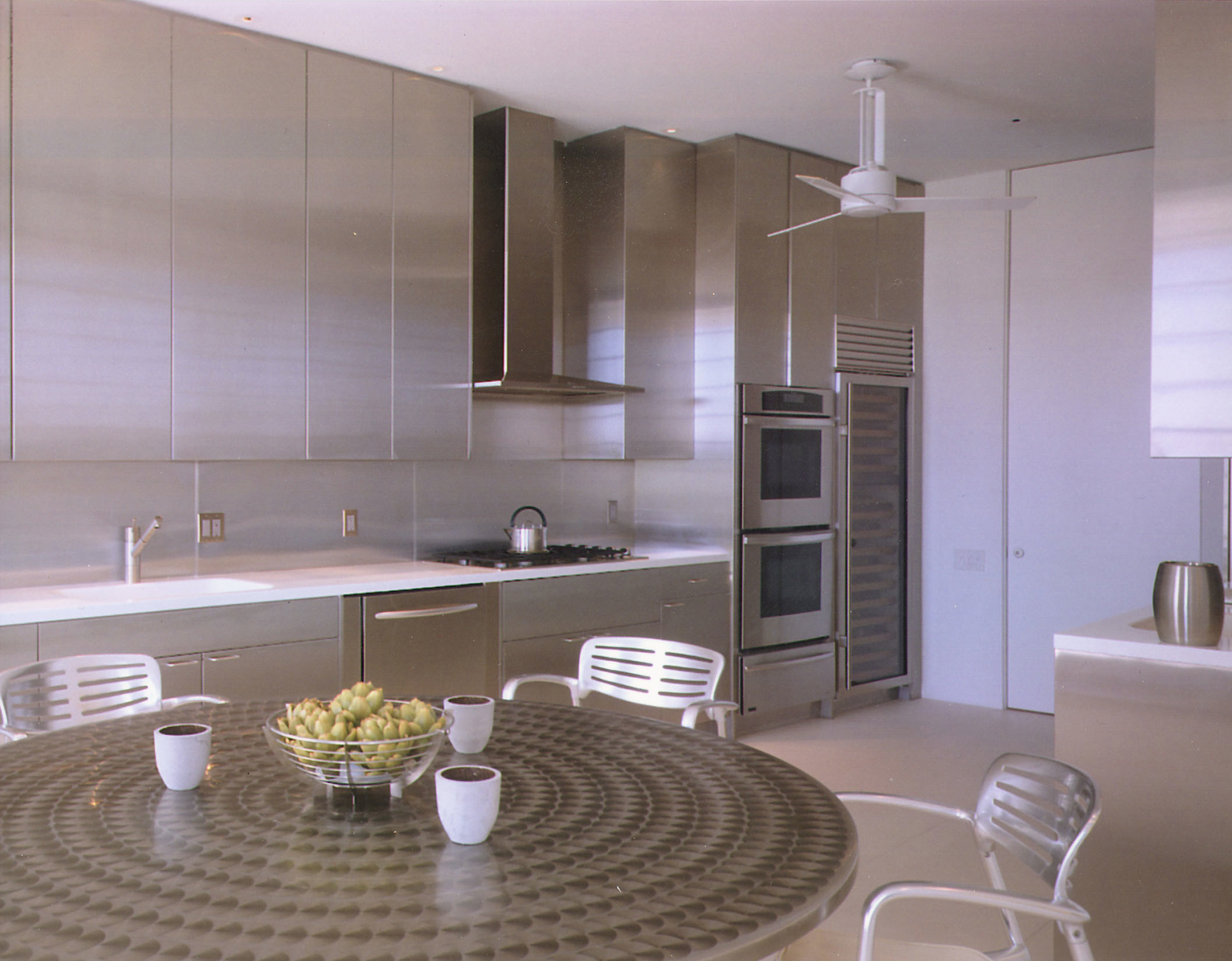 Stainless steel cabinets offset by pure white Corian counters in Florida.