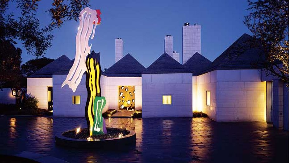 A Roy Lichtenstein sculpture and front door at the entrance...