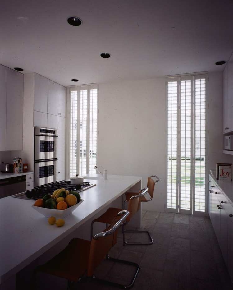 Full height windows and shutters give the space a better human proportion.