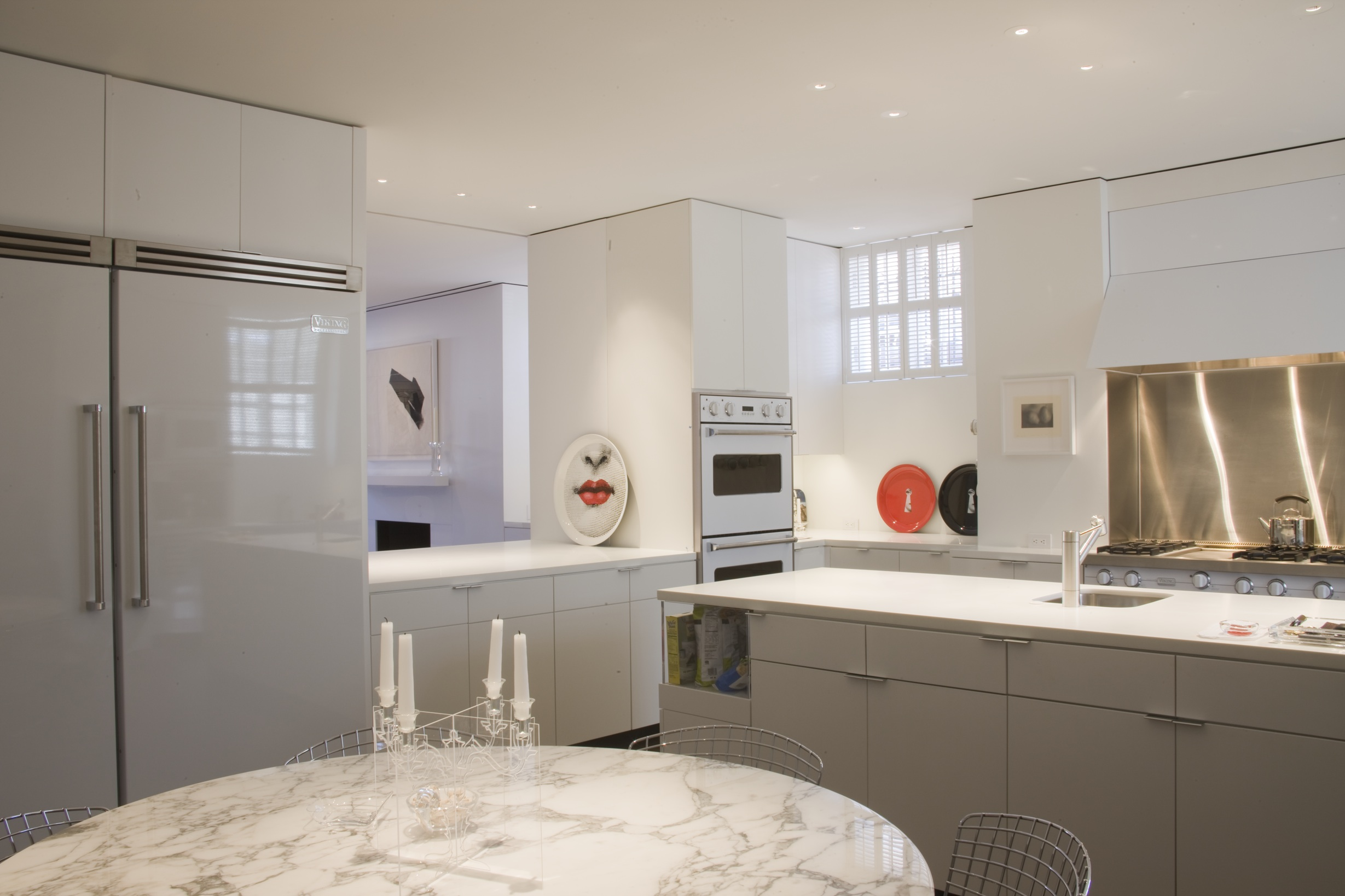 Corian, Carrara marble and painted stainless is the solution for this kitchen in Georgetown, DC.