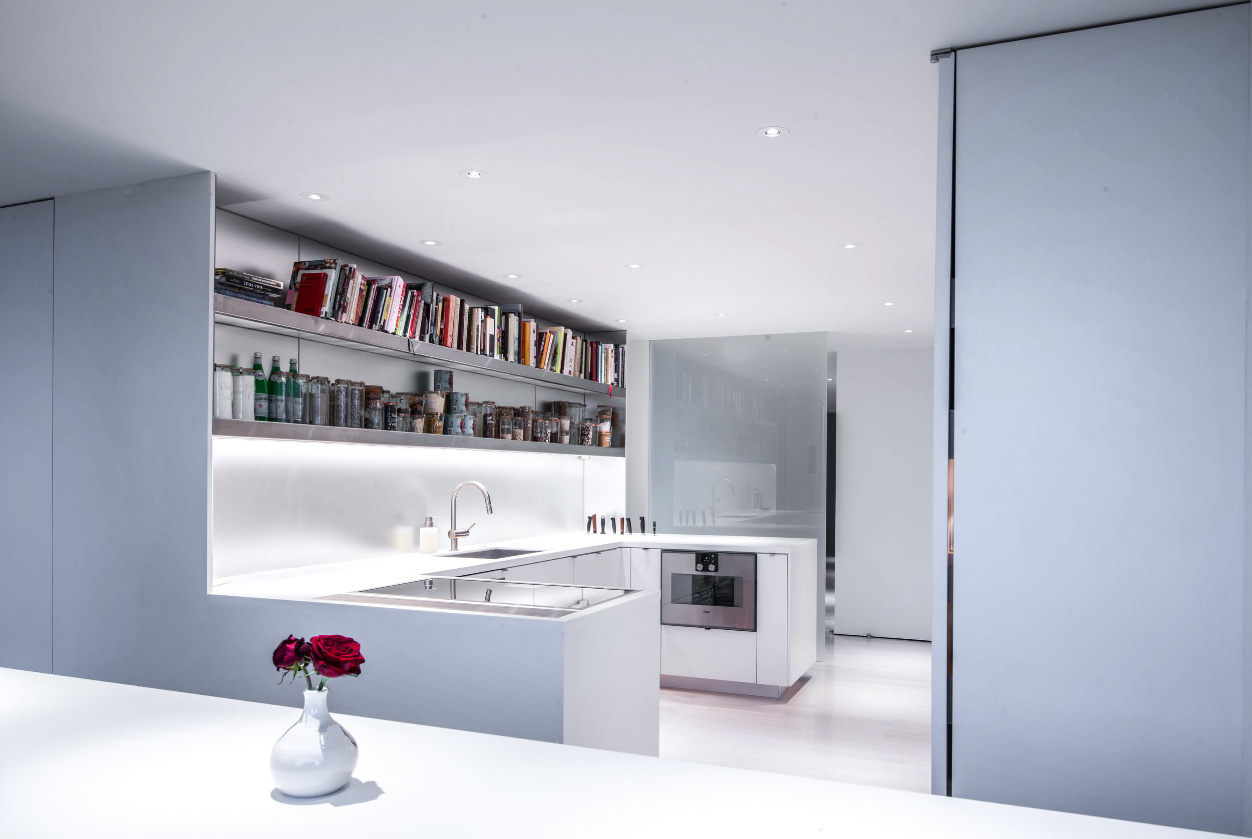 Open shelves and a seamless kitchen in this apartment in Alexandria, Va.