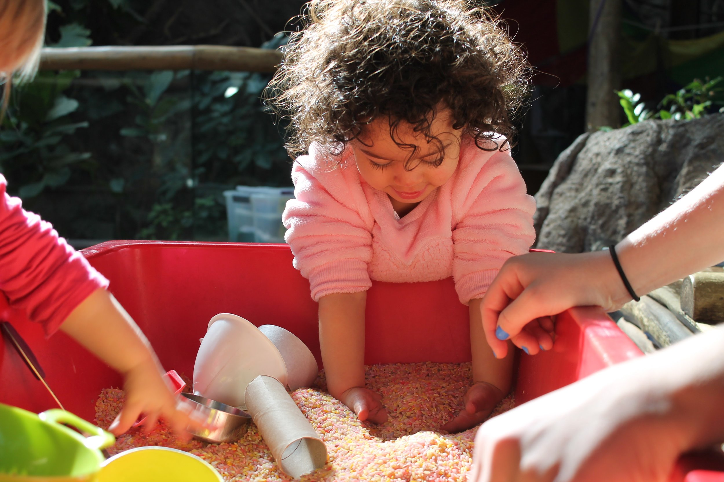 Digging, burrowing and scooping in the sensory bin allowed toddlers to touch and explore new materials