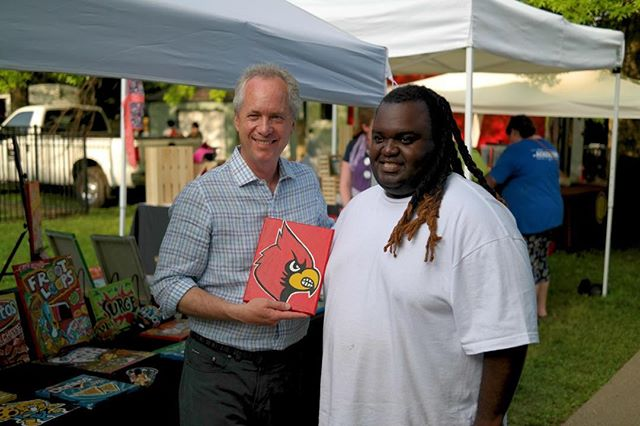 You never know who will show up at Springfest. Chimel Ford who did the Derby poster this year and Mayor Fischer talking Cardinals.