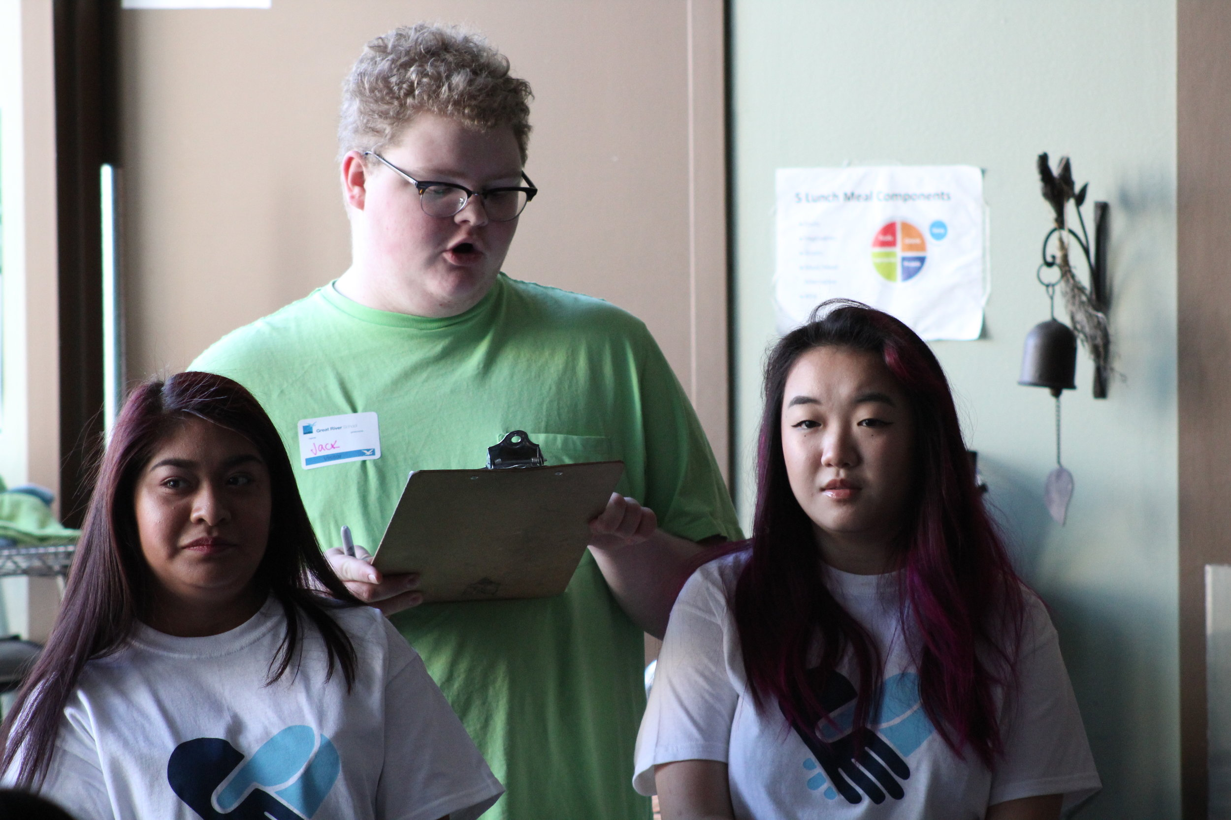 iRace student organizers Jack Spicer, Estefany Enriquez, and Britney Thao