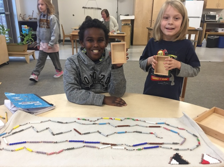 Two students find the value of all the positive and negative bead bars from the Negative Snake Game
