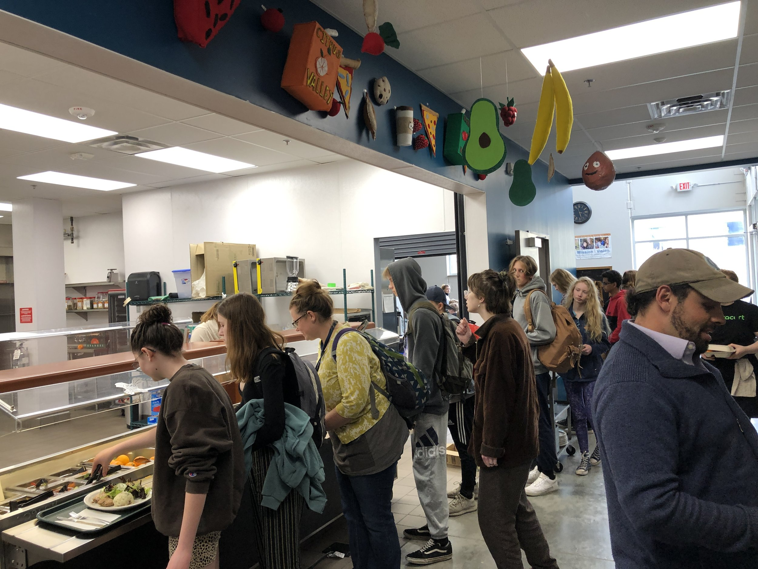Adolescent students in Laura Machacek's Sculpture elective created hanging food decorations to help beautify our kitchen environment.