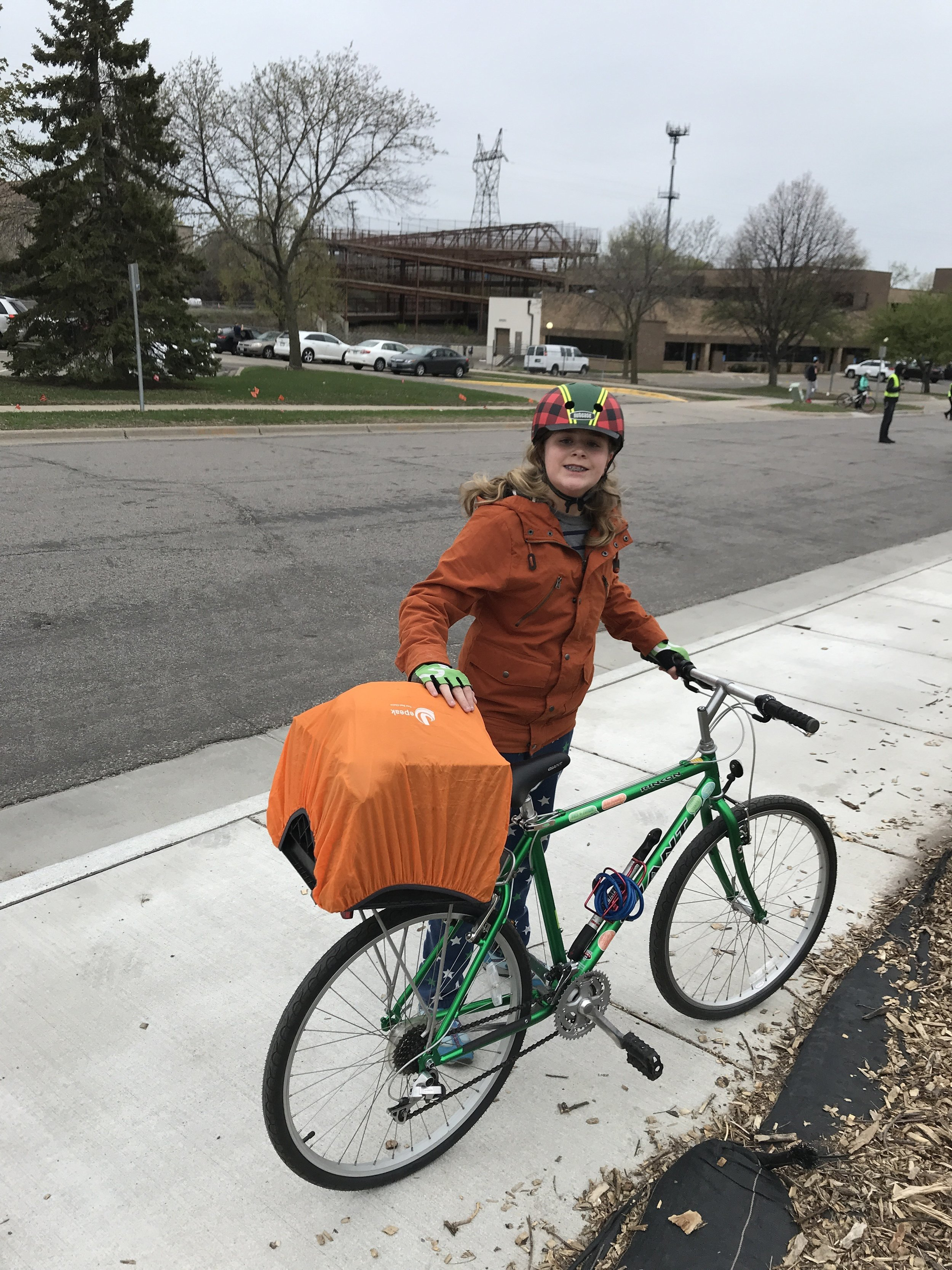 Everett Thomas models rain preparedness on a bike