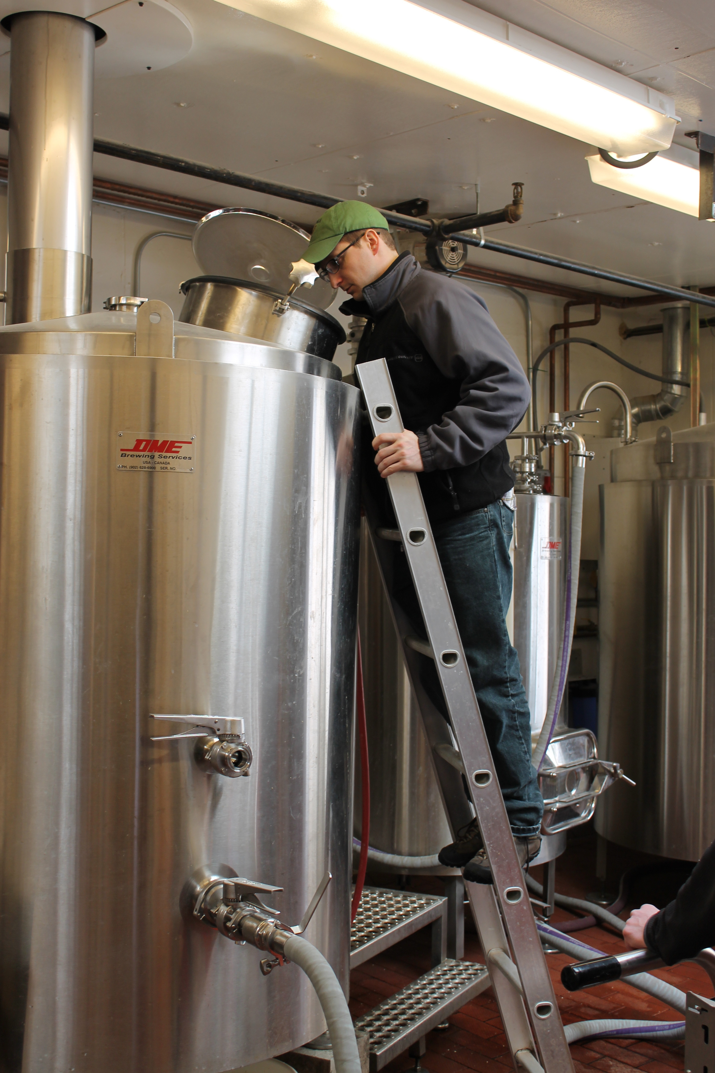 Douglas Amport (Bitter and Esters) brewing a commercial batch of beer at Rockaway Brewing Company in March, 2015.