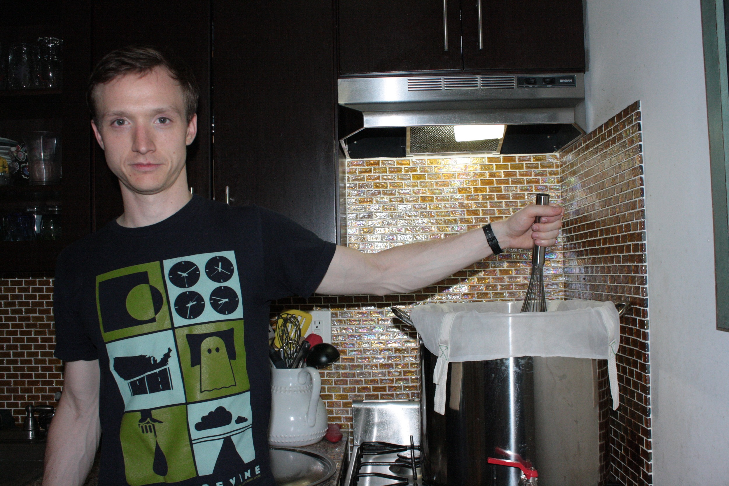 Glen Cupples at home with his brewing equipment.