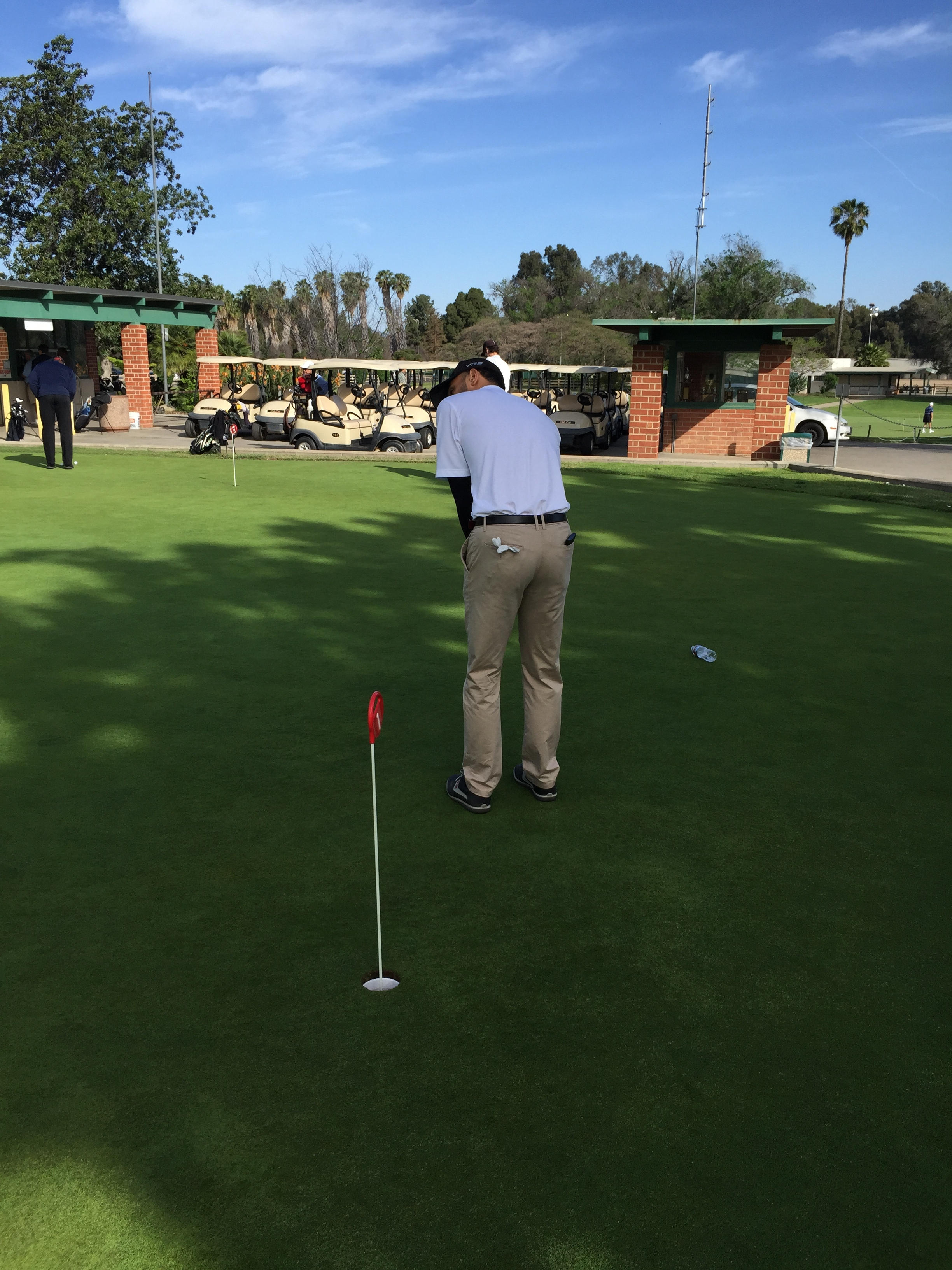 Vice President, Robert Brown | Lining Up for the putt.