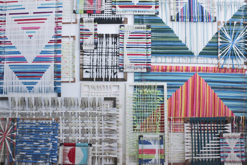 Layered Wall of woven textile art displayed on frame looms. Art by Jamie Tubbs, 2015.