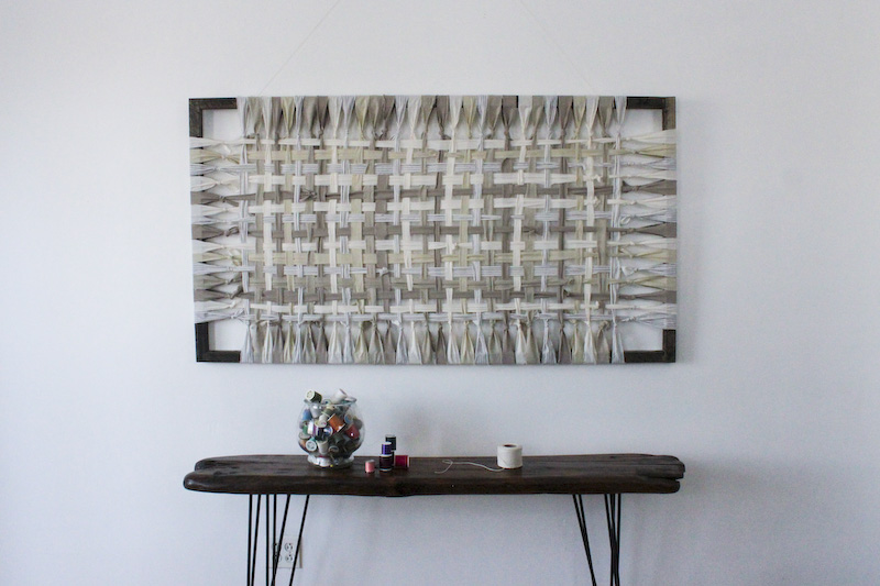 sustainably sourced textiles woven on a frame. Wall art by Jamie Tubbs