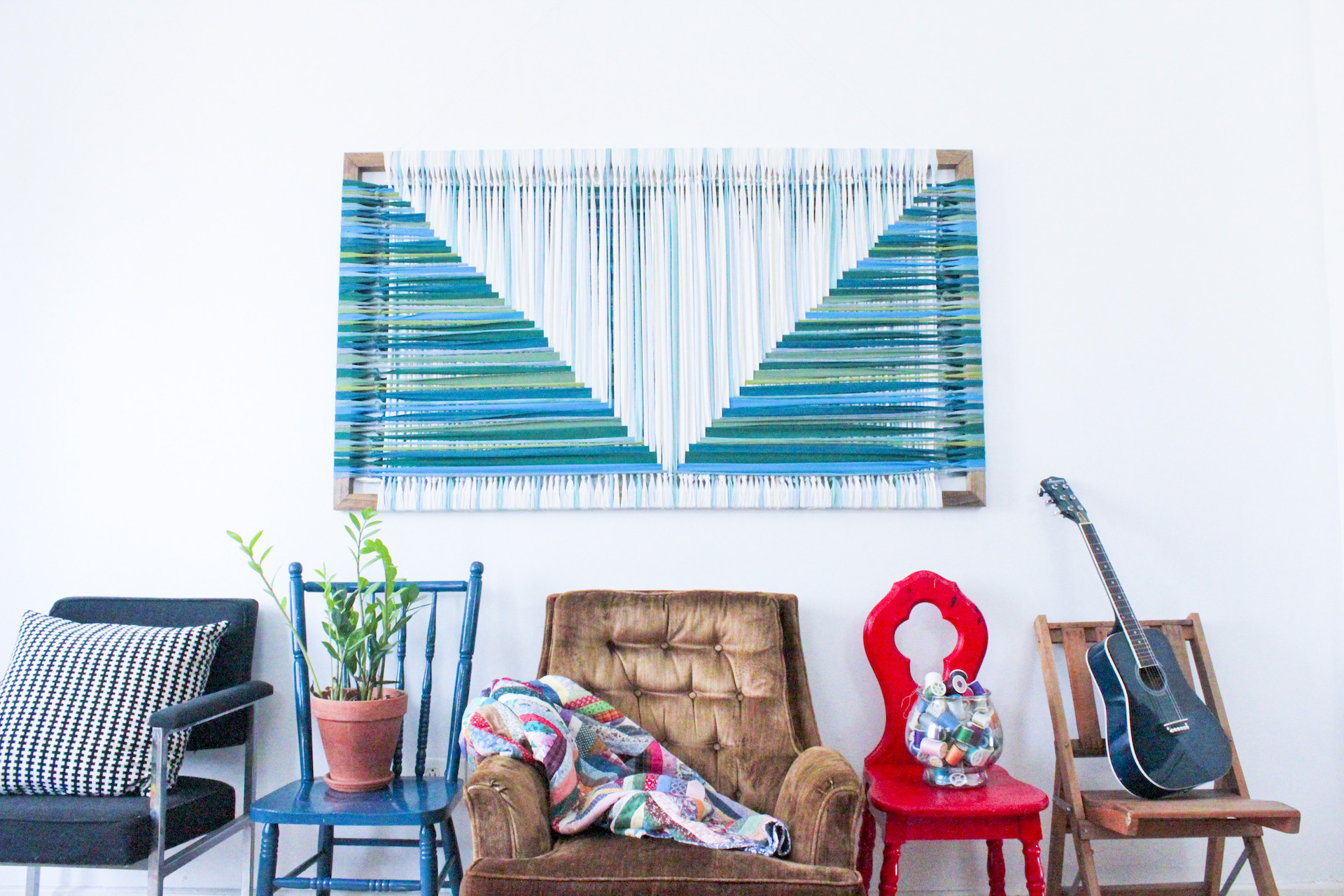 Bright blue, green and white graphic woven textile art.