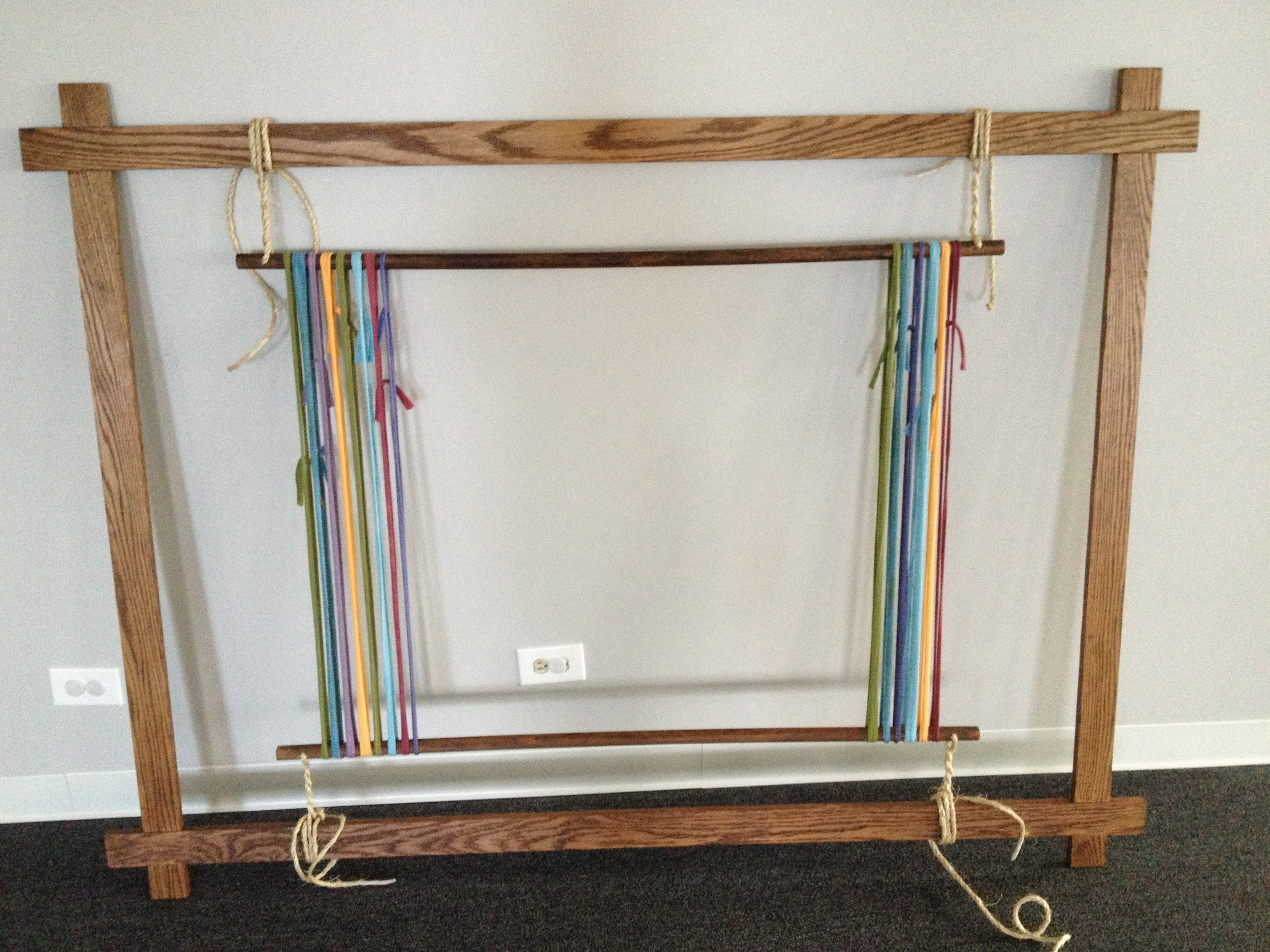 This was my first execution of my concept of a loom wall hanging. I can't believe looking at it now that I hand tooled those joints. I had to take care of a baby part way through and Nate finished them for me. Not much has changed there.