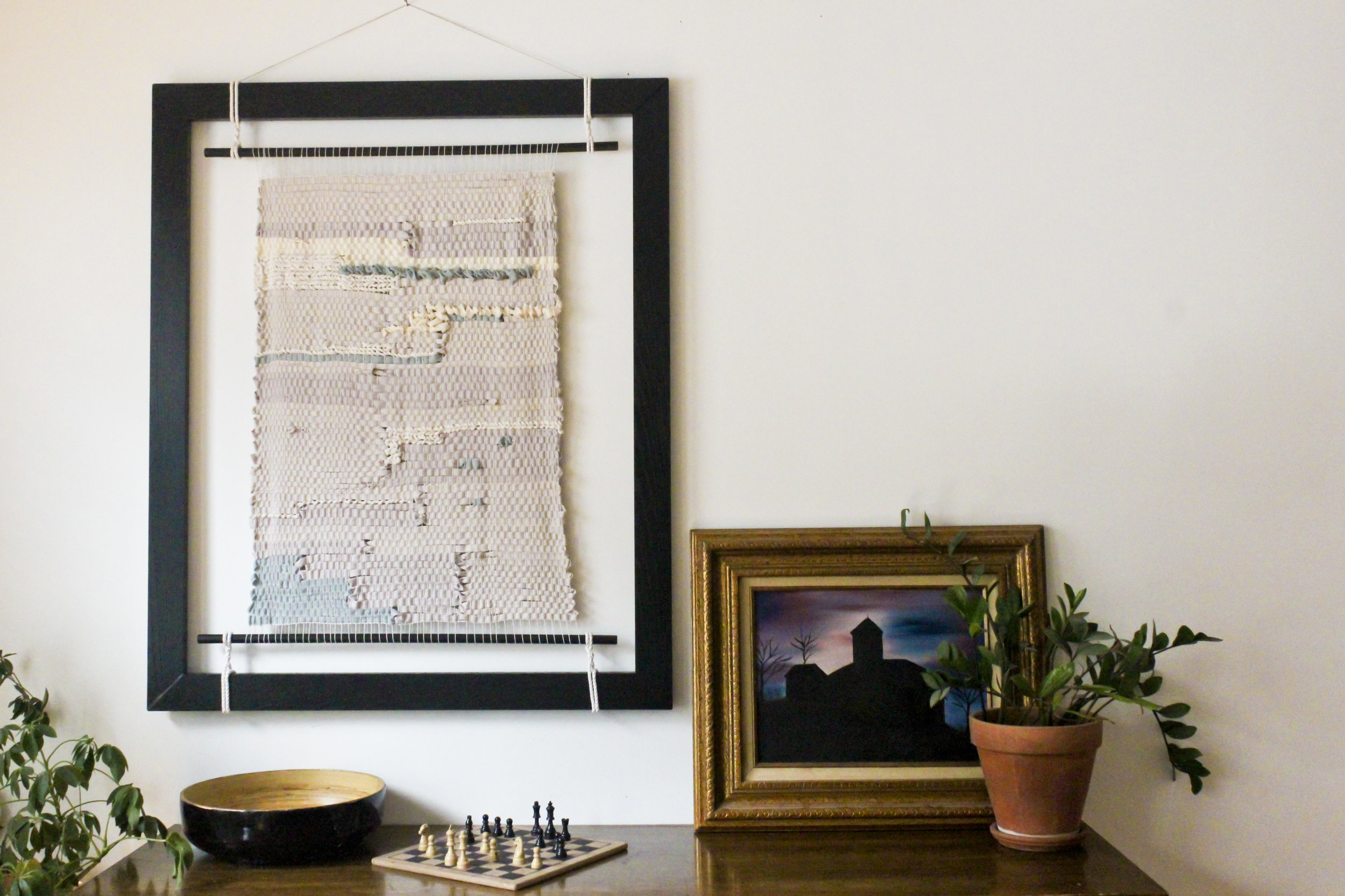 in 4 out 8. textile art woven with recycled fabrics on black frame with apron rods.