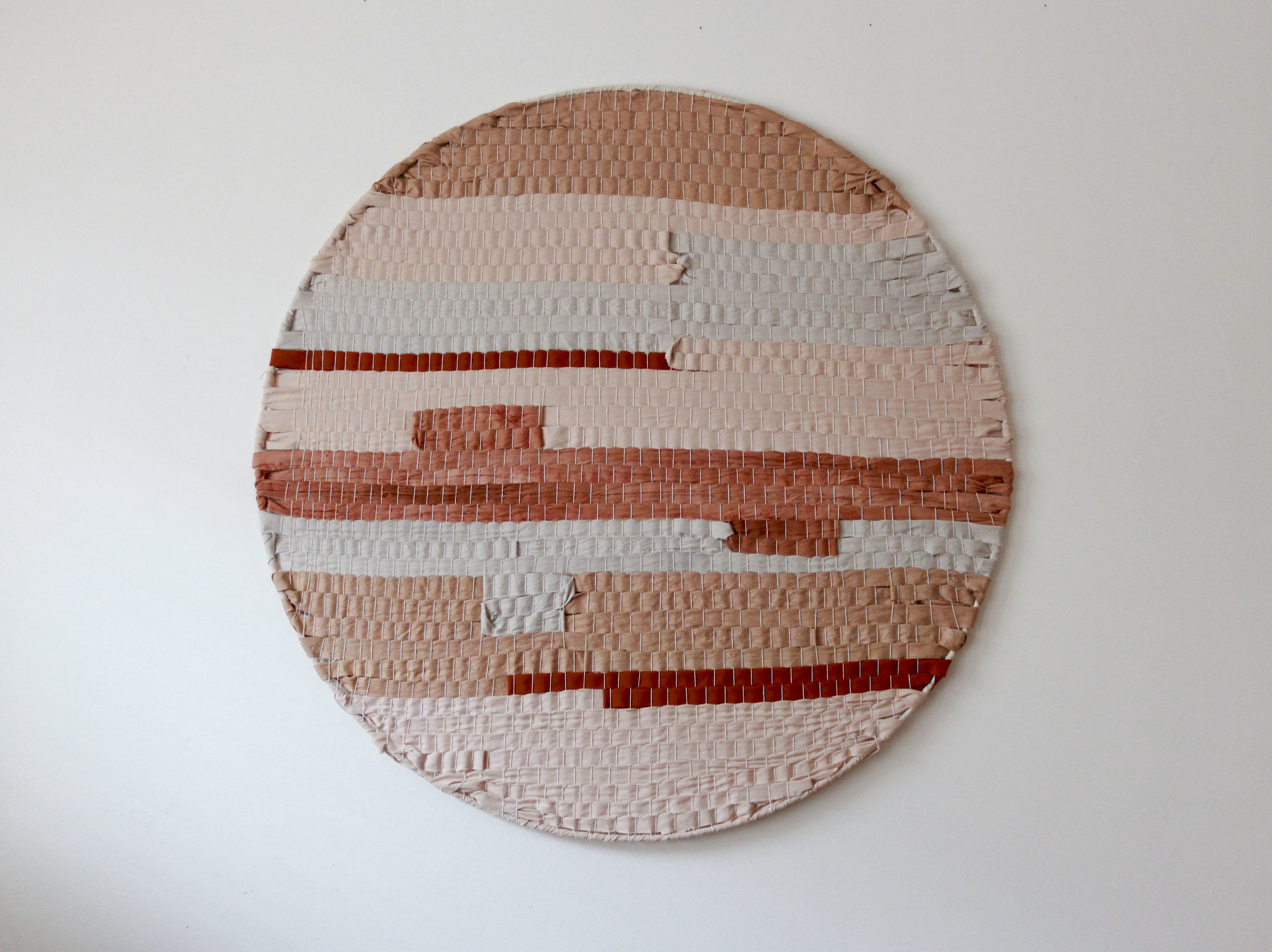 coral, blush, salmon, rust woven strata circle by Jamie Tubbs