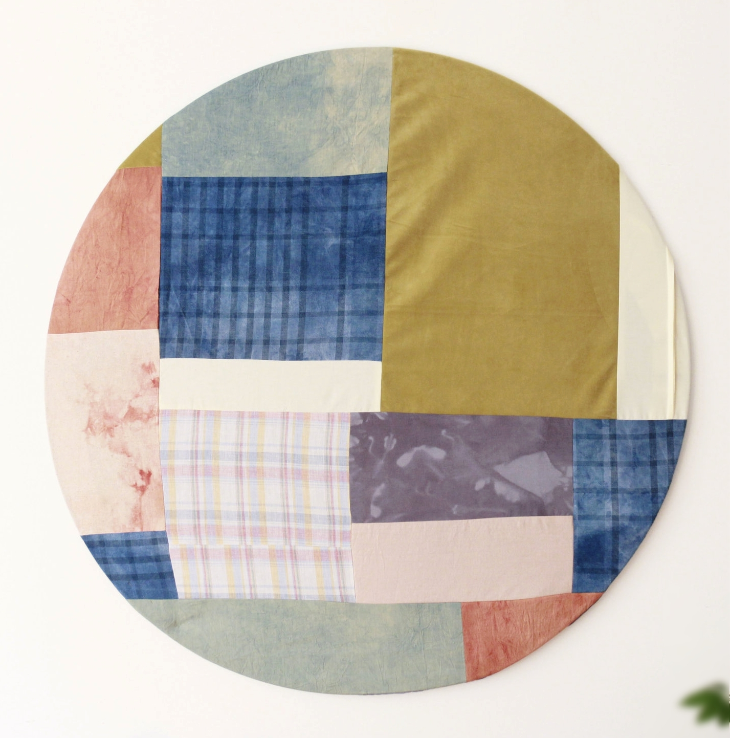 quilted circle art, hand-dyed fabric scraps in indigo, madder root.
