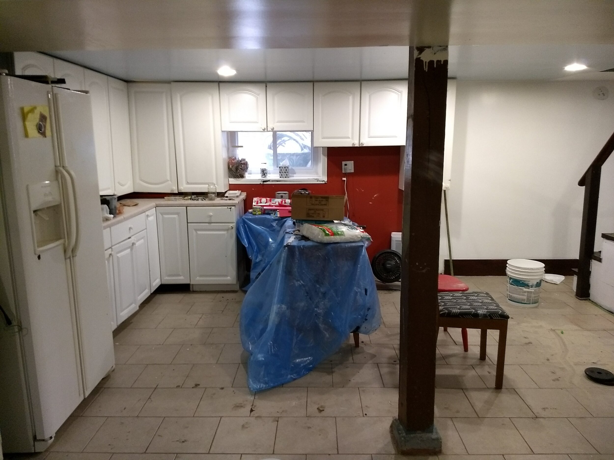 Same room, Before. Repurposed lower cabinets as workbenches.
