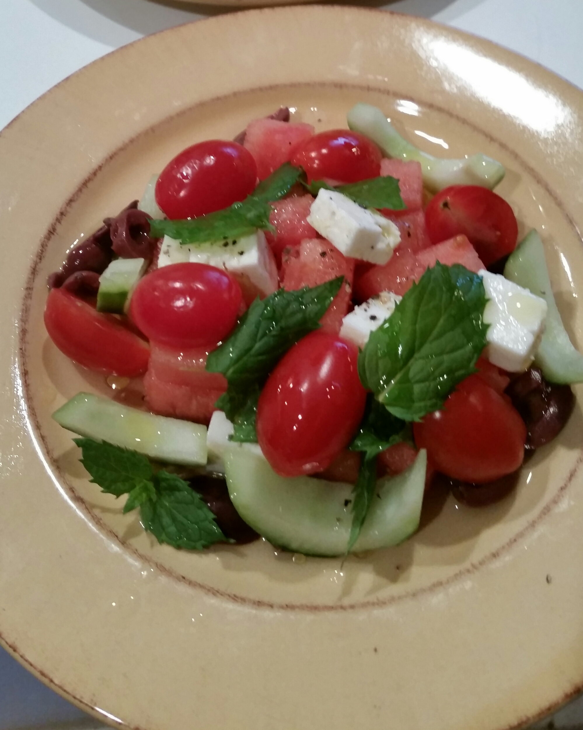 This is a simple Watermelon Feta Salad with Tomatoes, Cucumber and Kalamata Olives.  Fresh mint gives great flavor to any dish.  I finished it off with some fresh cracked pepper, olive oil, lemon juice and a champagne vinegar.  The sweetness of the fruit and the salt in the cheese makes for a delicious and healthy combination.