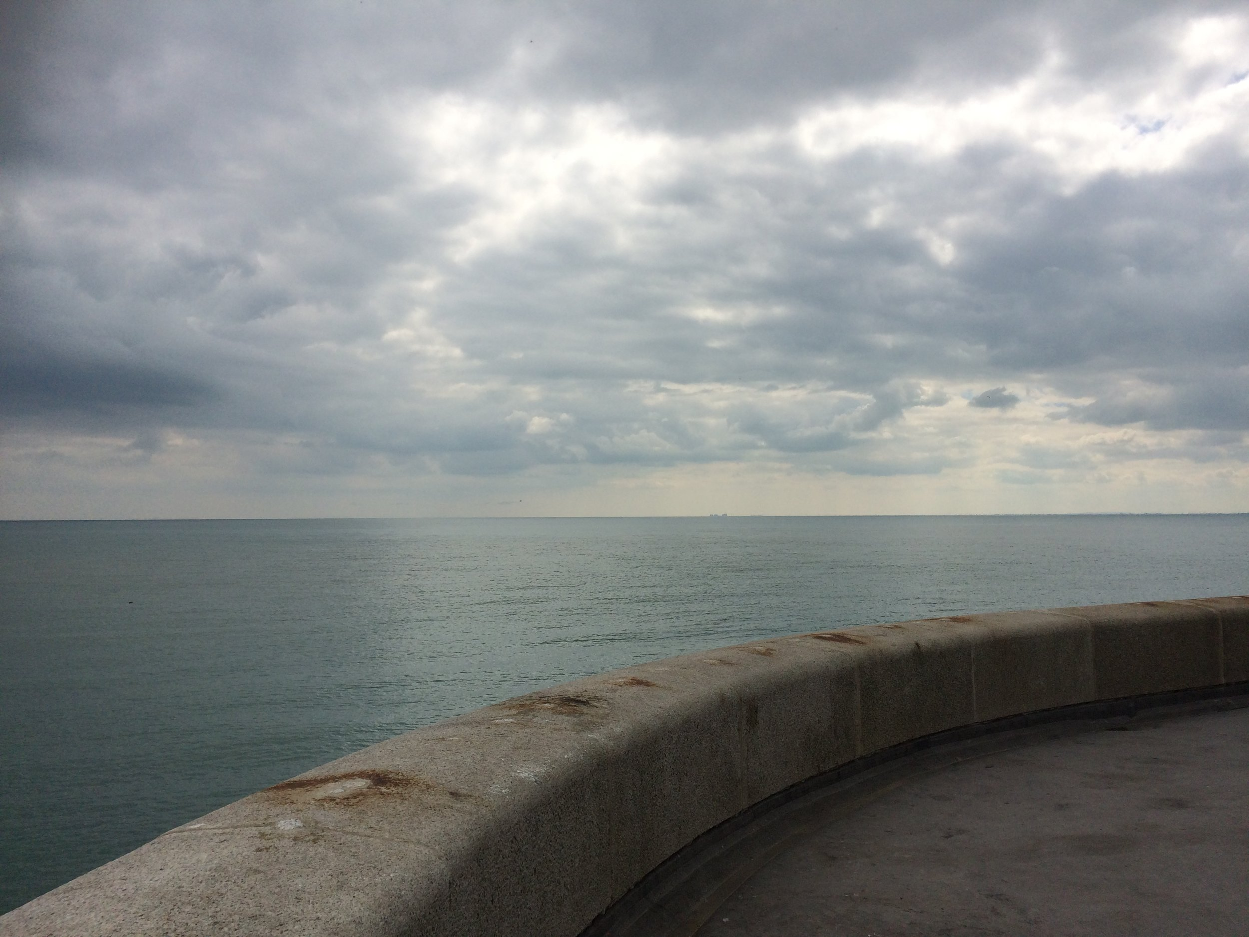 Gazing towards Dungeness from the arm that stretches out from Folkestone's harbour
