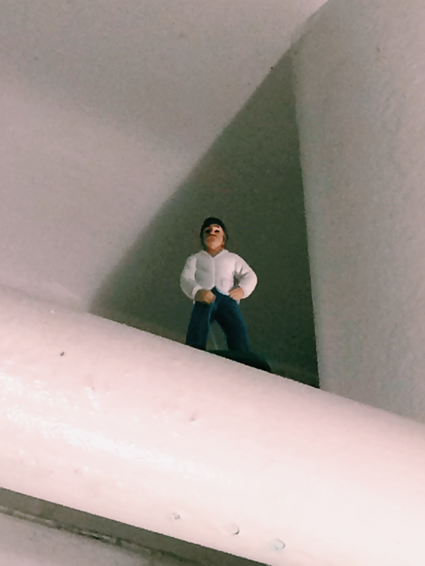 A man peeing on your while you wash your hands in the bathroom. You can find toys all around on the house on these ceiling pipes.