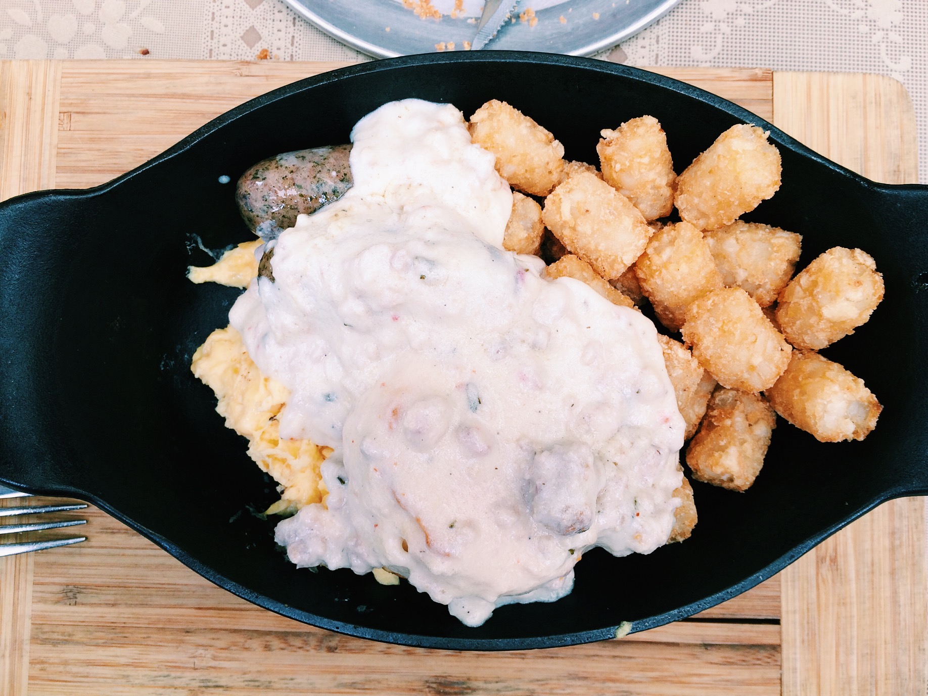 The Cure, probably for your hangover. Biscuit, tots, sausage, eggs, and gravy.