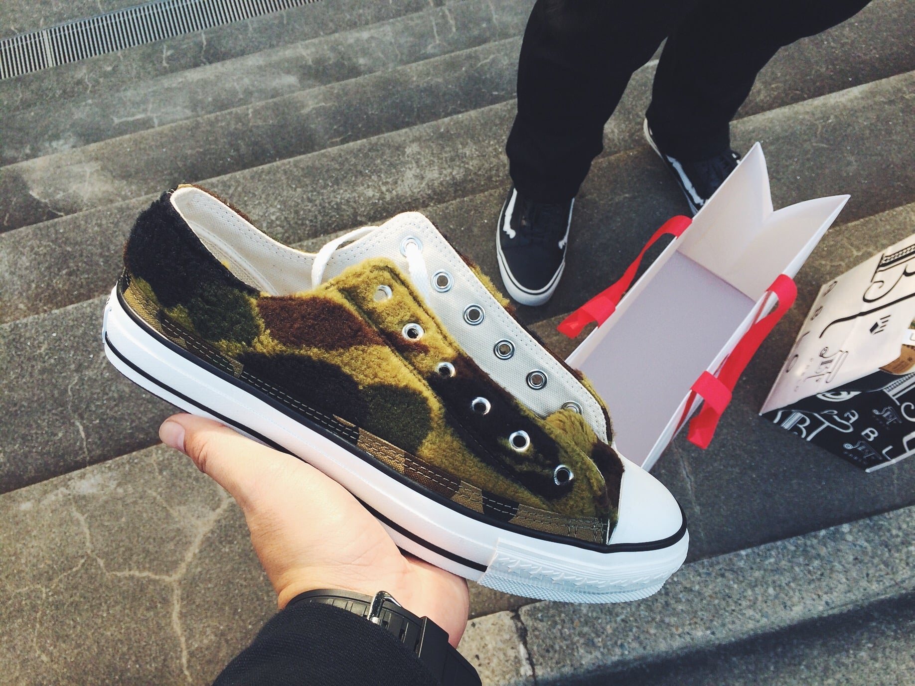 Since I didn't get anything for my brother for Christmas I bought him this Bape shoes. Bape's employees walked us out, handed him the bag and bowed. Tradition out here is dope.