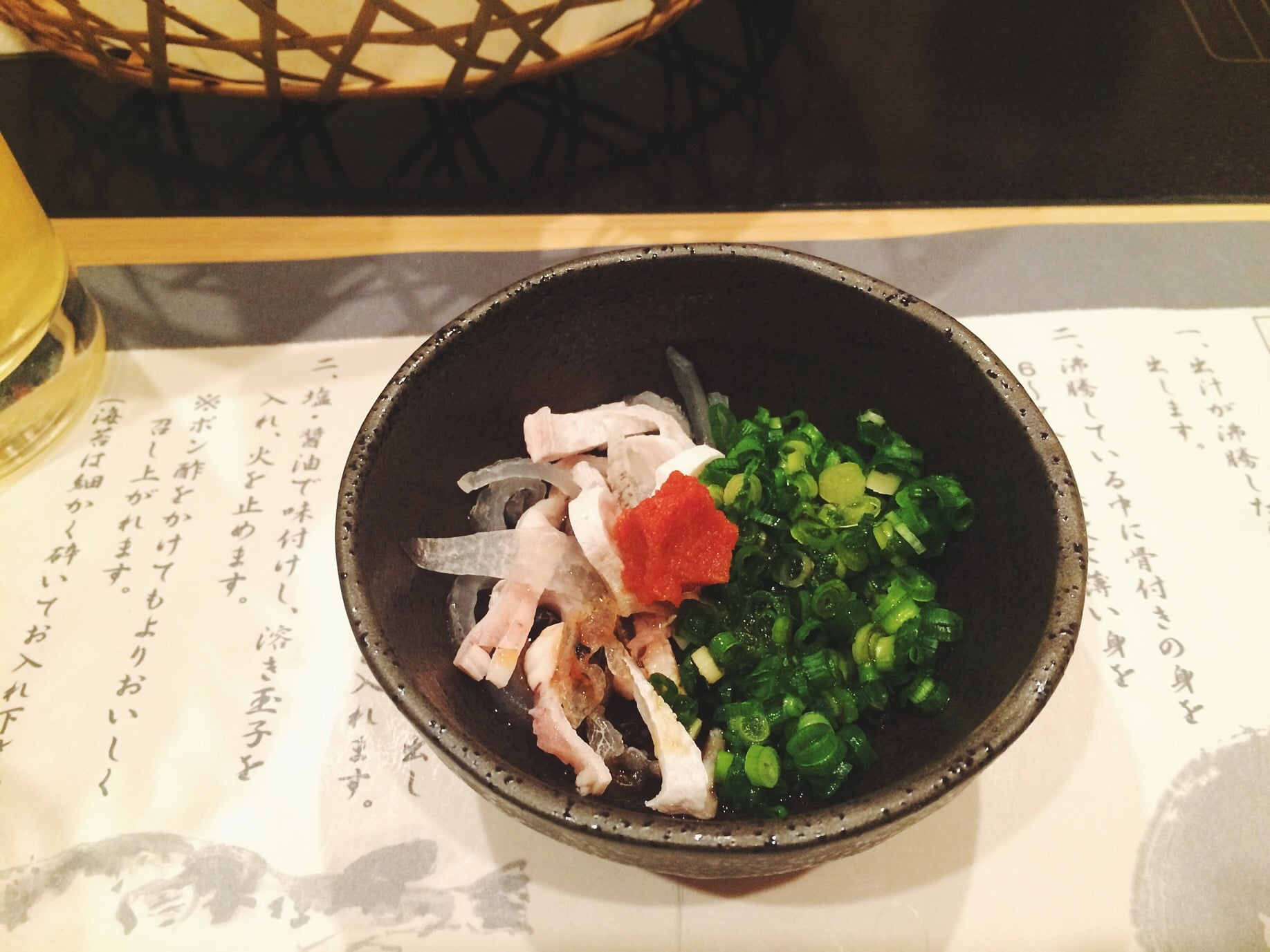 """Fugu (Blowfish) skin in chopped chives and some sauce and I don't know what that red thing is but """"fuck that's delicious."""" I ate Marteena's bowl because she ain't down for that raw fish."""
