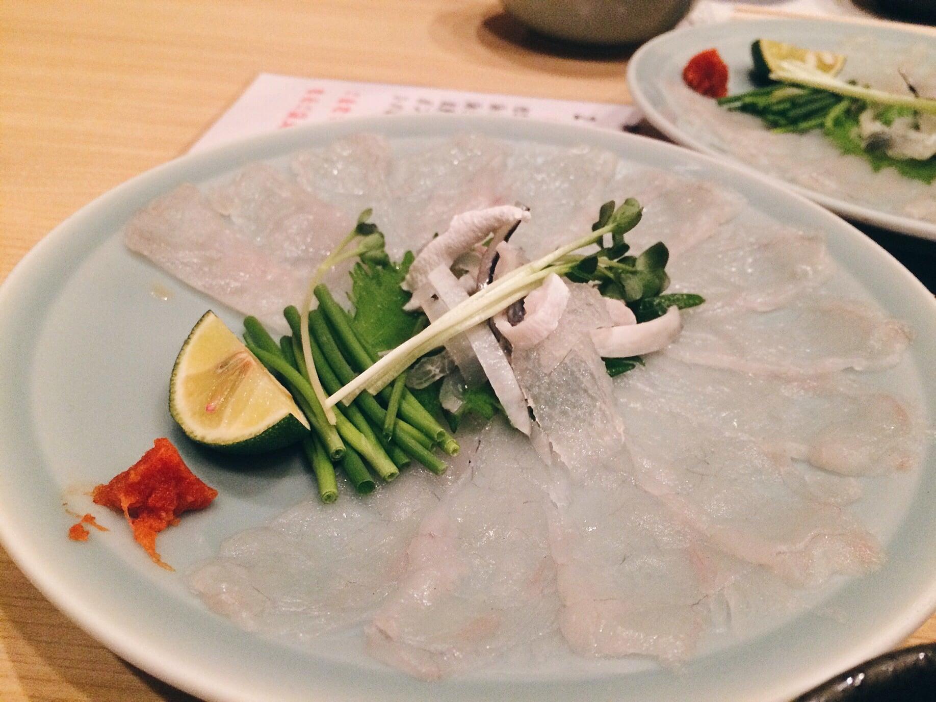 Fugu sashimi, taste pretty damn good!