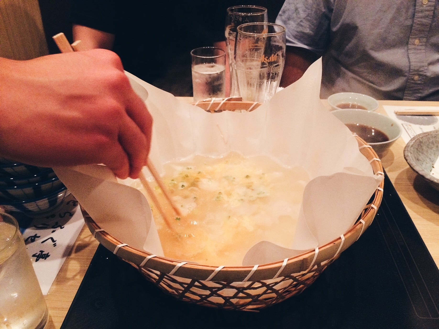 After we finished the hot pot, the waiter came in to whip something up using the broth in front of us. Great way of not wasting food. He dumped rice in it, then eggs and a tea spoon of soy sauce. What we get from it is magic ya'll. It was surprisingly good! Like a egg drop soup basically.