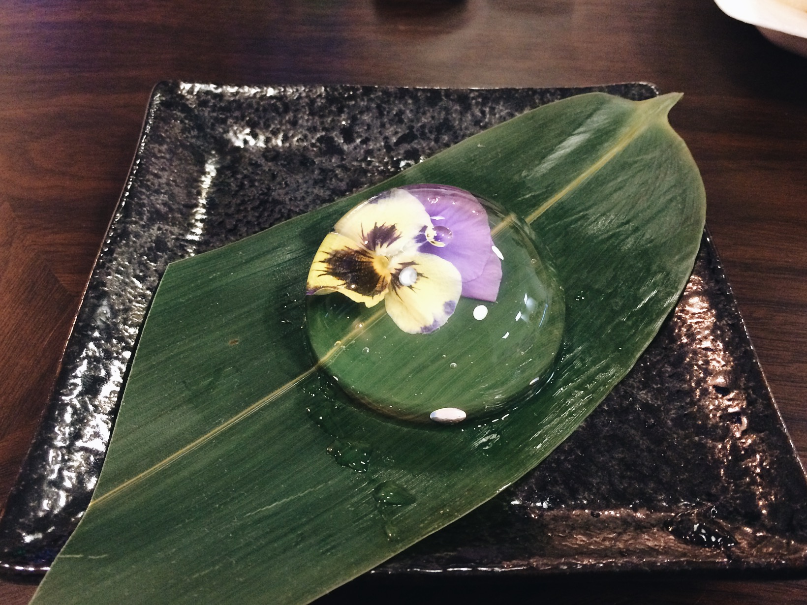 Rain Drop Cake. At first bite I was like, shit taste like a rain drop. It had no flavor, like I was actually eating water. But it came with syrup and some powder that you sprinkle on top of it and damn it was sweet! But good! very cool looking cake.