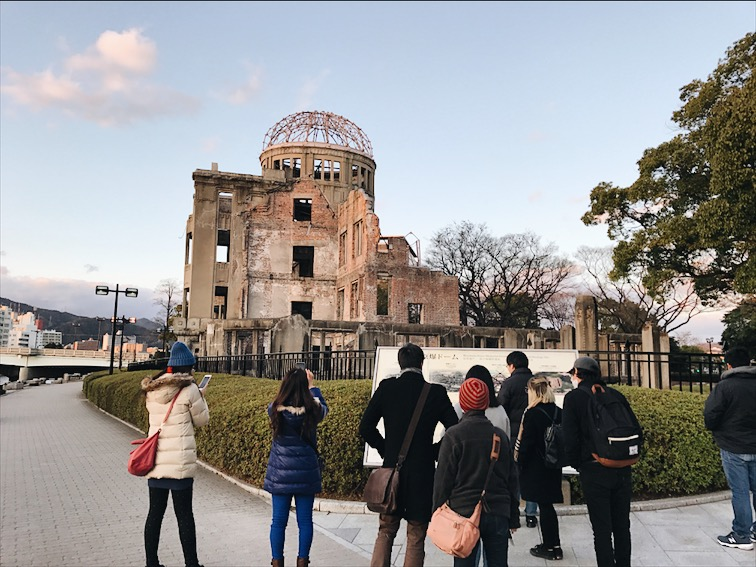 The A-Bomb Dome, the bomb site. The Atomic bomb exploded above this building and took out everything else surrounding it. Very very emotional to be standing here reading the history on it.