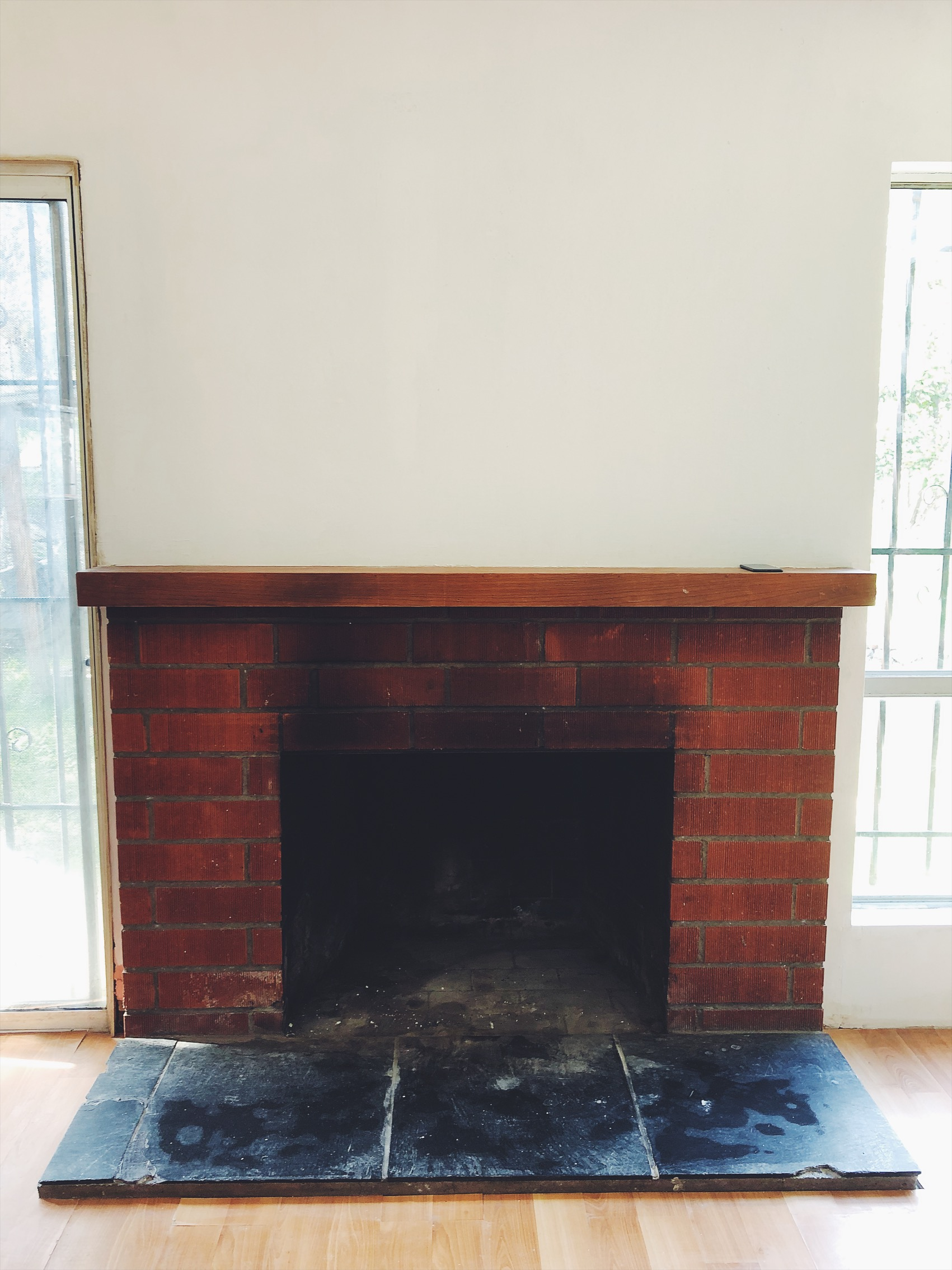 Here's a picture of my fire place with the walls painted white. I'll do a full blog post when the house is done with Before and after photos.