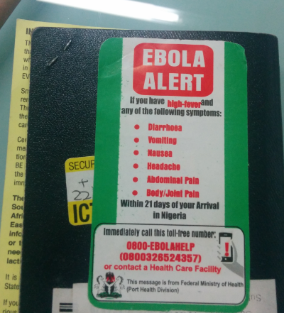 Passport Sticker with Ebola Symptoms and National Helpline. Photo Credit: Sulzhan Bali, PhD