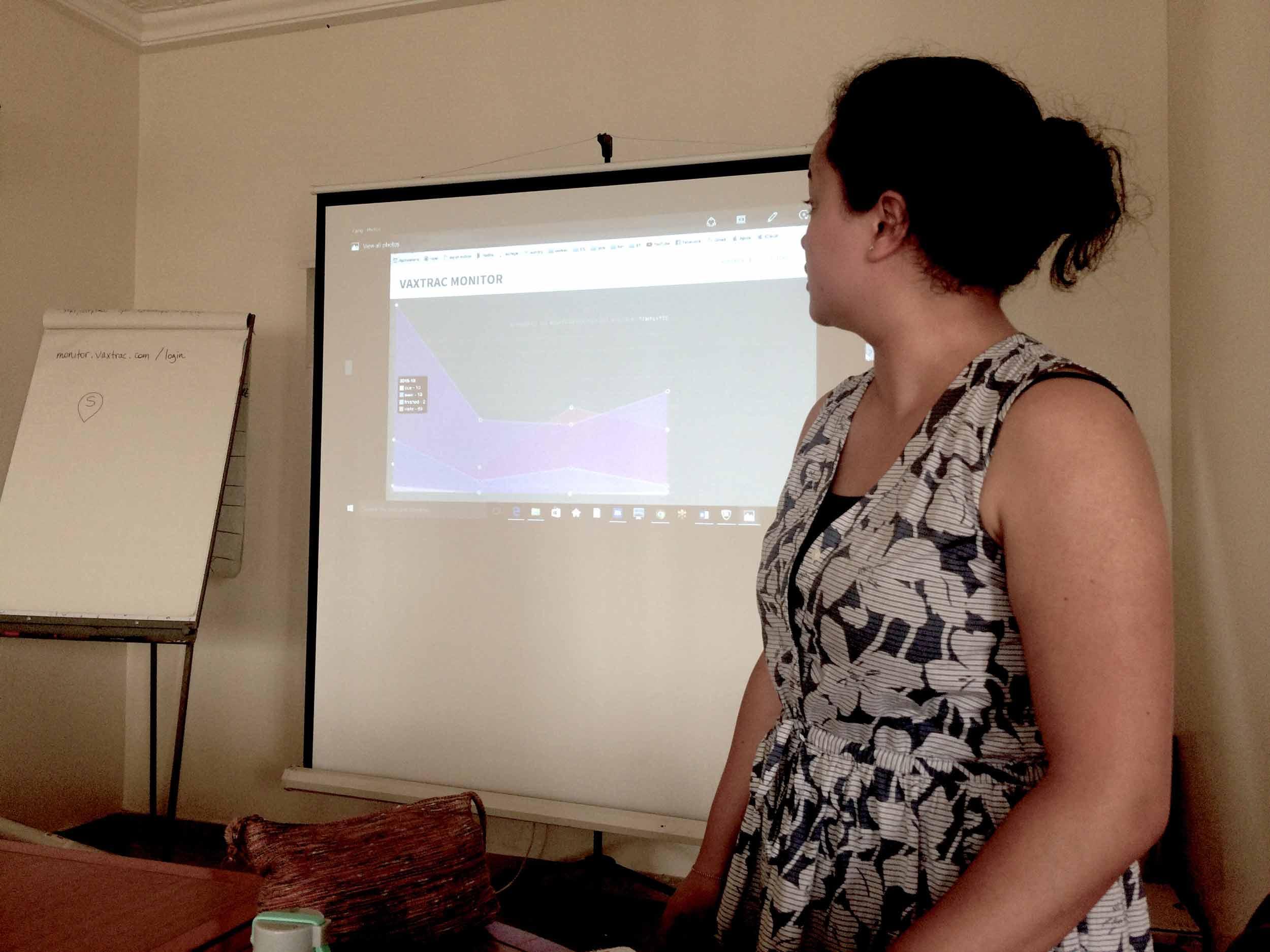 Sam facilitating the feedback session on VaxTrac monitor