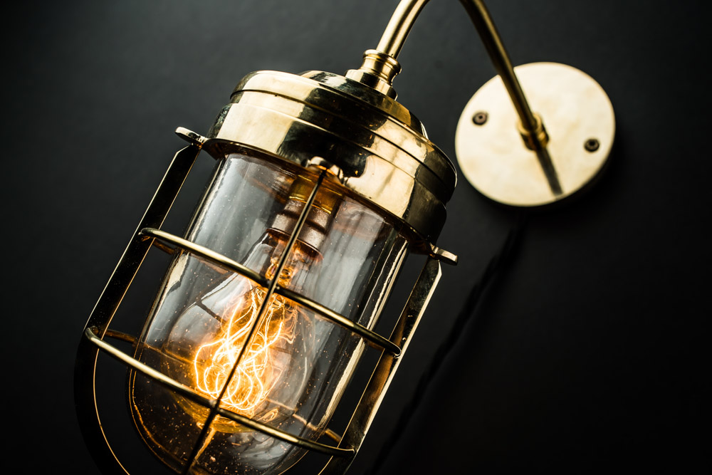 Exterior/Interior Solid Brass and Caged Glass Wall Light